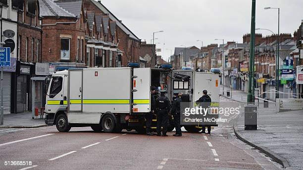 PSNI officers attend the scene following a suspected car bomb attack on a prison officer at Hillsborough Drive on March 4 2016 in Belfast Northern...