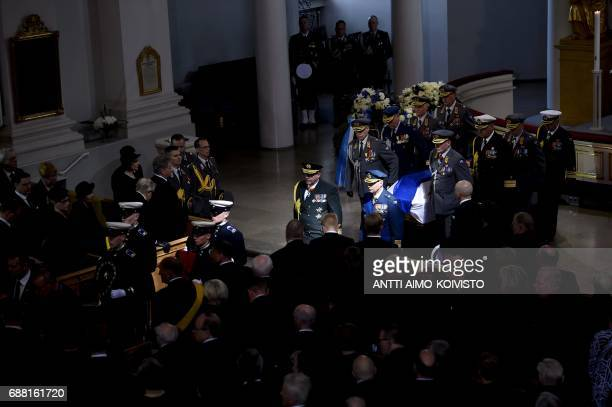Officers carry the coffin of Finland's former President Mauno Koivisto as they leave the Cathedral in Helsinki during the state funeral ceremony on...