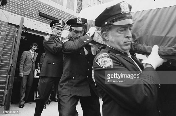 NYPD officers carrying the coffin of colleague Tommy Schimenti killed in the line of duty in New York City 1980