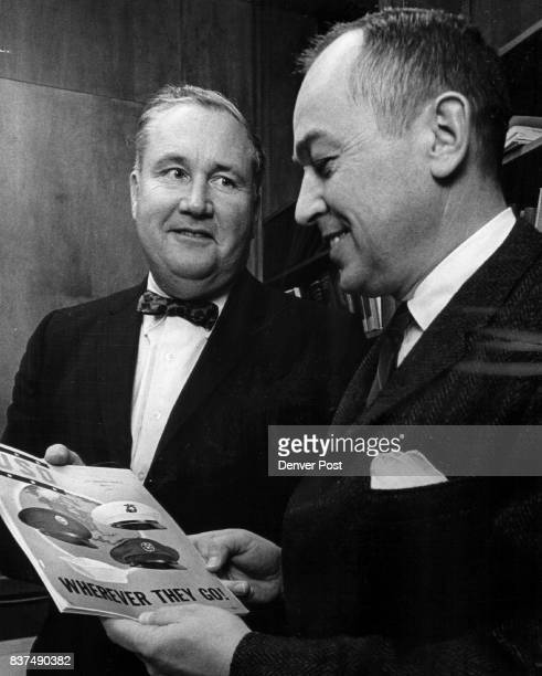 Officers Confer Walter C Emery left new USO State chairman discusses the organization's magazine with Henry Heyser retiring the chairman Credit...