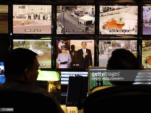 Officers directing the massive security operation surrounding the State Visit by US President Bush watch over monitors showing CCTV and news images...