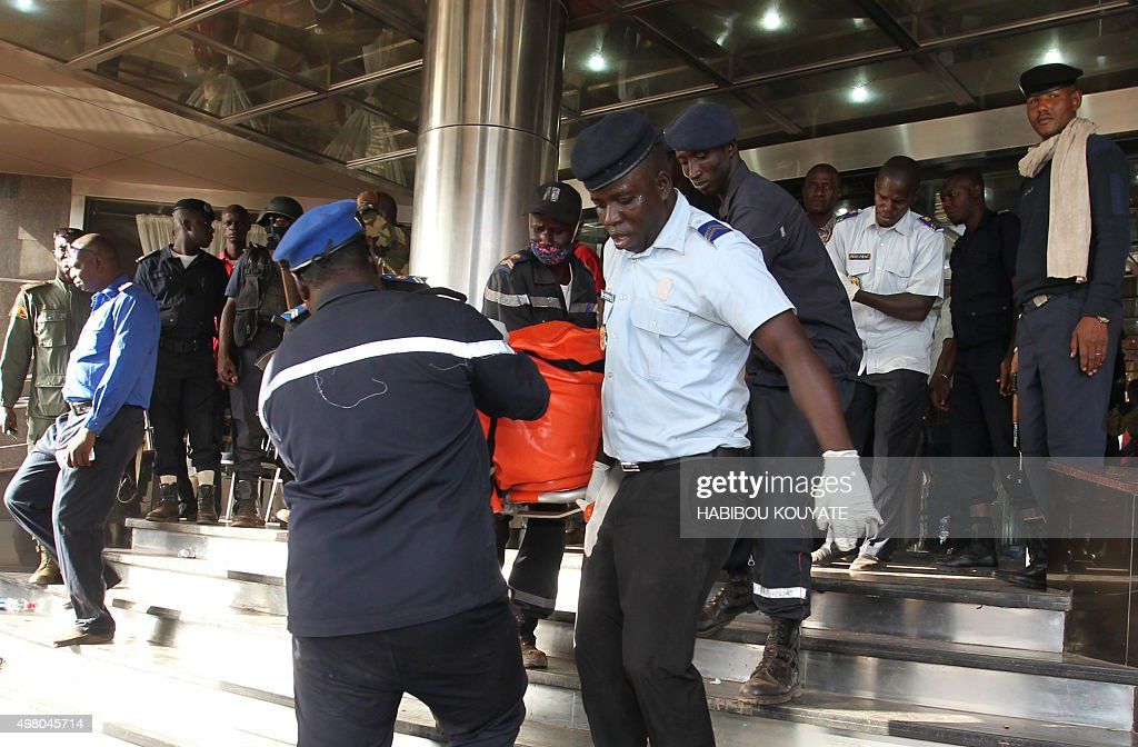 Officers evacuate bodies of victims from the Radisson Blu hotel in Bamako on November 20 after the assault of security forces Malian forces backed by...