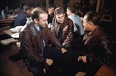 Officers from both the US Army Air Force and Royal Canadian Air Force talk in the Mess Hall at the base in Goose Bay Labrador Canada