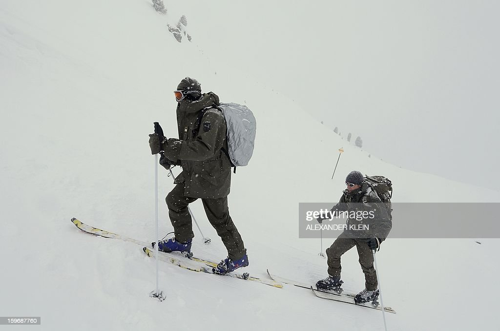 Officers from the Austrian armed forces from the 6th Infantry Brigade (6. Jaegerbrigade), of the 2nd Engineer Battalion Salzburg (Pionierbatallion 2), walk up the mountains with touring skis during an alpine training winter exercise (above 2000m altitude) during a foggy and snowy day in the Tuxer mountains near Wattens on January 16, 2013. Austrians will decide on Sunday whether to maintain compulsory military service or switch to a professional army in a referendum that has split the small, neutral country.