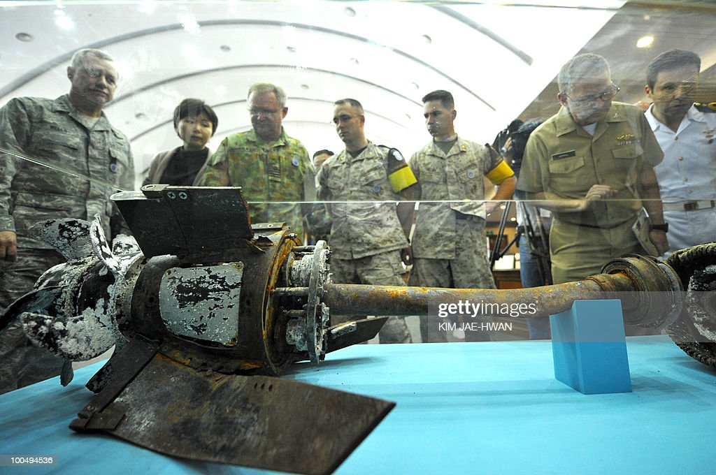 Officers from the United Nations Command inspect a broken section of what Seoul claims to be a North Korean torpedo, which was salvaged near the disputed sea border and displayed at South Korea's defence ministry building on May 25, 2010. South Korea said a North Korean submarine torpedoed one of its warships in March. For a fair probe, South Korea invited inspectors from the UN command, which has overseen a truce accord since the 1950-53 Korean conflict.