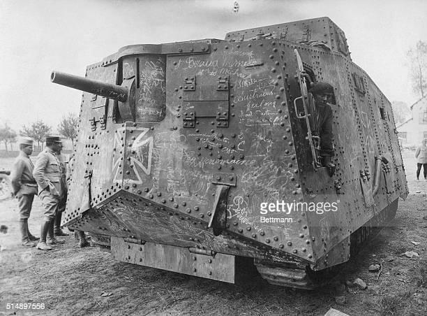 Officers look over a German A7V tank captured at VillersBretonneux France during World War I