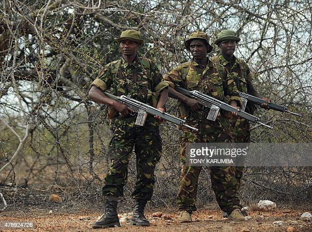 Officers of a rhinoprotection team stand guard at the release site of black rhinocerous at the Sera community conservancy in Samburu county some 350...