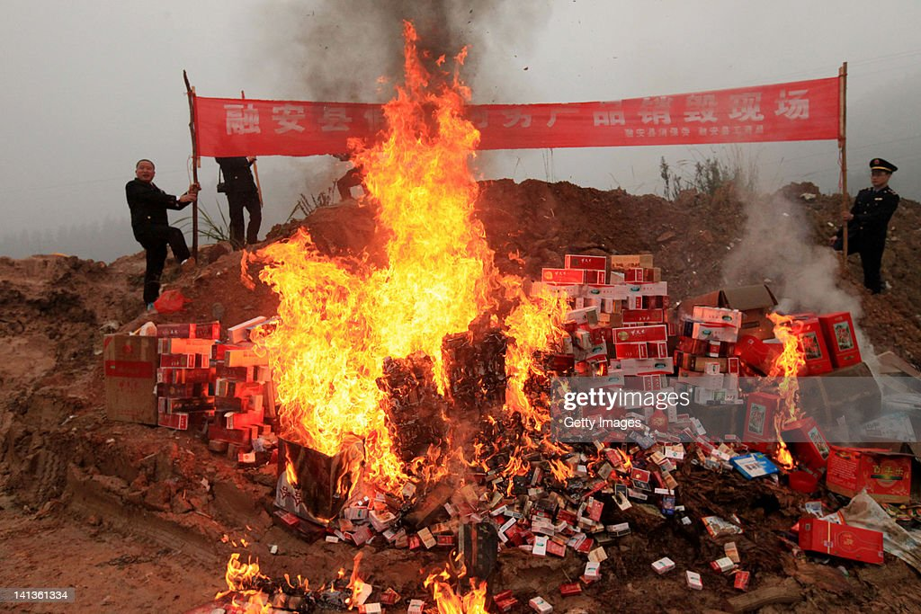 Officers of Administration for Industry and Commerce destroy fake cigarettes on March 14, 2012 in Liuzhou, China. China marks World Consumer Rights Day (WCRD) on March 15 each year, aiming to protect consumer rights and interests. The theme for WCRD 2012 is 'Our money, our rights: campaigning for real choice in financial services'.