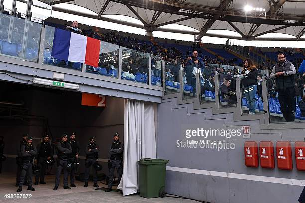 Officers of Guardia Di Finanza look on as a French flag is displayed in memory of Paris victims during the Serie A match between SS Lazio and US...