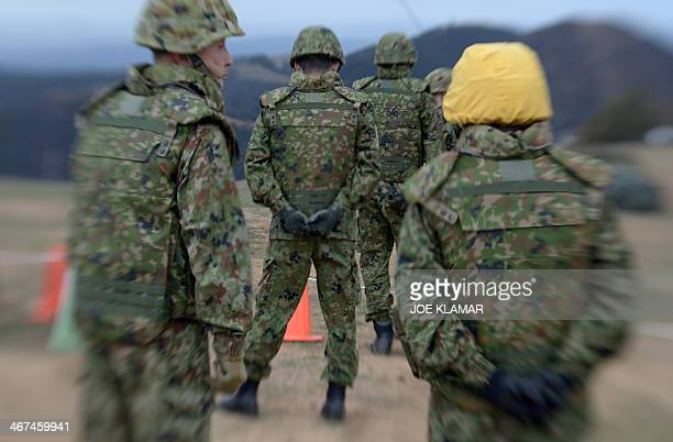 Officers of Japan Ground SelfDefense Force watch their troops participate with US Marine Corps of the Expeditionary Fire Support System during the US...