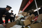 Officers of local Food and Drug Administration destroy fake medicine on March 14 2012 in Shijiazhuang China China marks World Consumer Rights Day on...