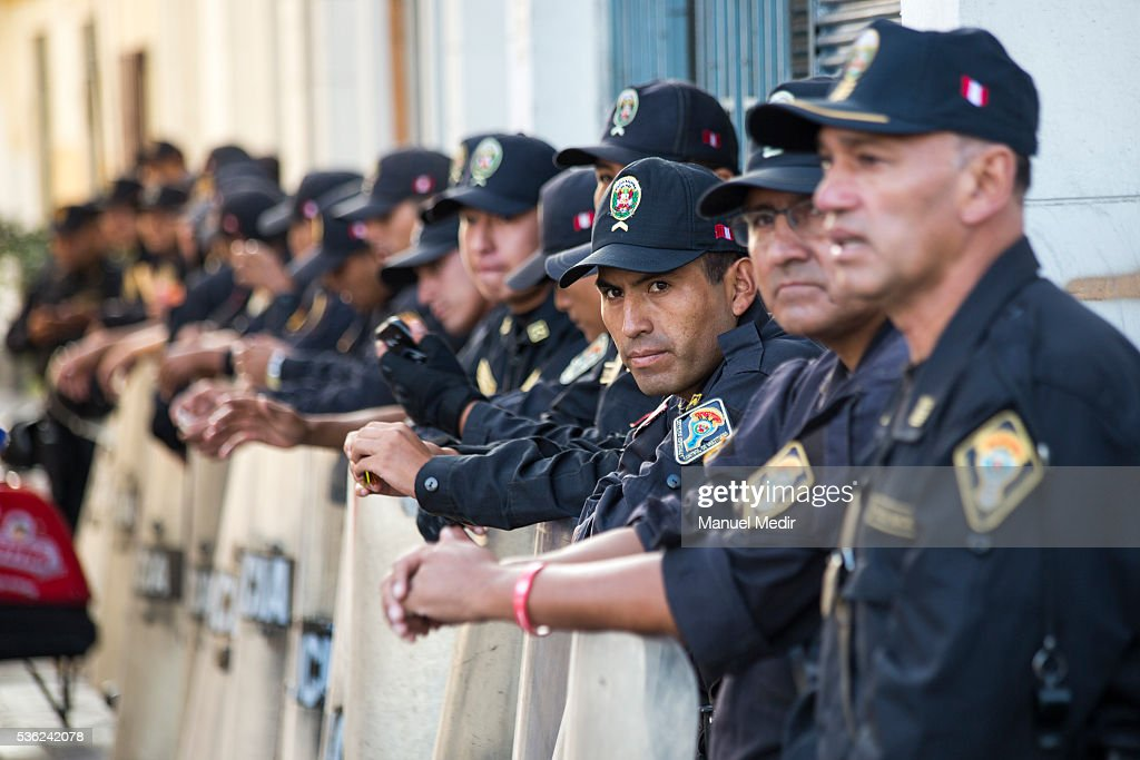 Officers of Riot police wait for a march on the streets of Lima's downtown to protest against Presidential Candidate Keiko Fujimori on May 31, 2016 in Lima, Peru. Fujimori will be competing for Peru's Presidency on the second round of the electoral voting next June 5th.