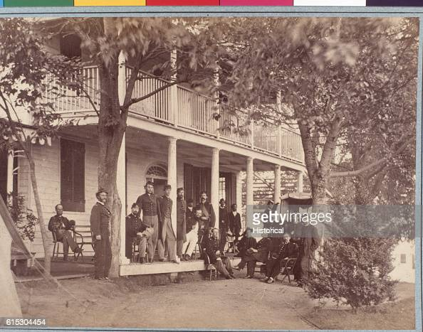 Officers of the 3rd Massachusetts Heavy Artillery pose outside their brigade headquarters at Fort Lincoln Pictured men include Lieutenant GP...
