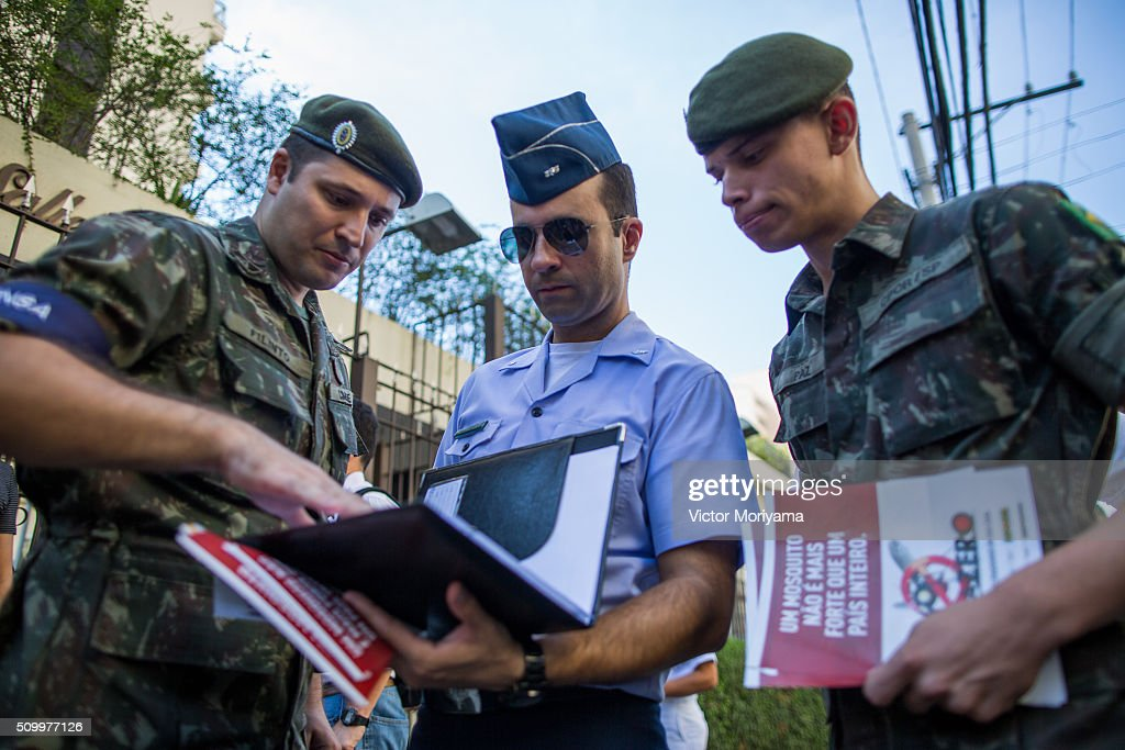 Officers of the Army, Navy and Air Force congregate during a day for reaching out to Brazilian residents in a push for public awareness of the Zika virus and the mosquito that transmits it in all Brazilian states on February 13, 2016 in Sao Paulo, Brazil. Today some 220,000 soldiers are working across the country to raise awareness.