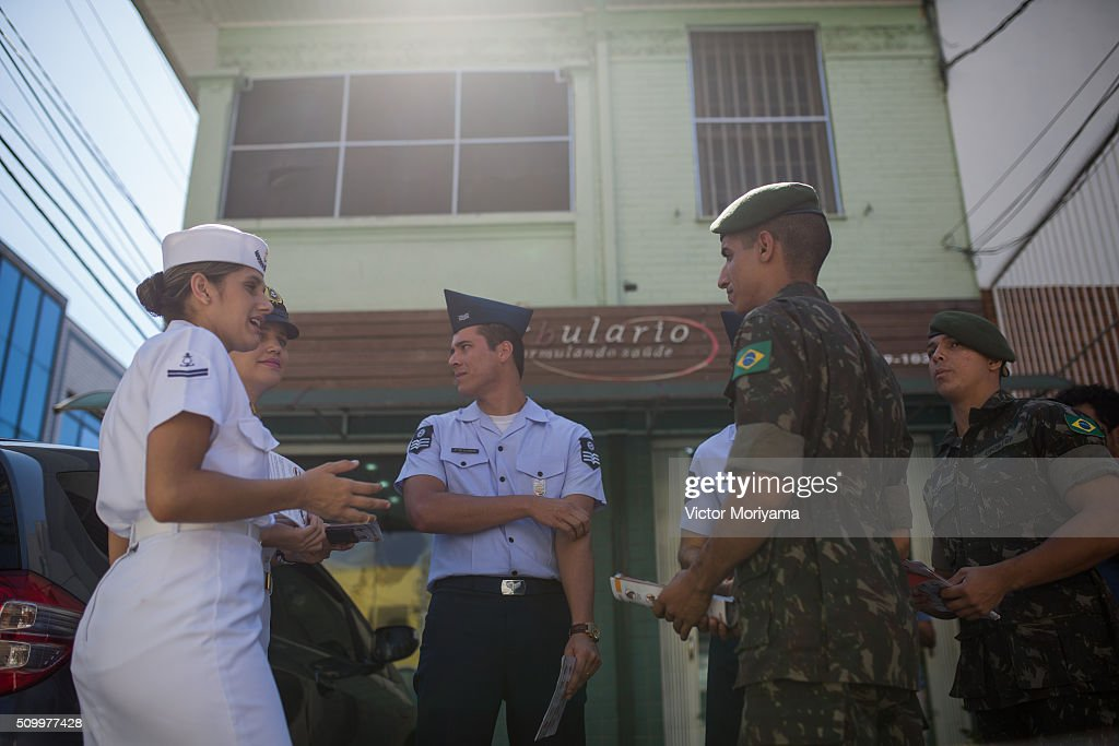 Officers of the Army, Navy and Air Force congregate during a day for reaching out to Brazilian residents in a push for public awareness of the Zika virus and the mosquito that transmits it on February 13, 2016 in Sao Paulo, Brazil. Today some 220,000 soldiers are working across the country to raise awareness.