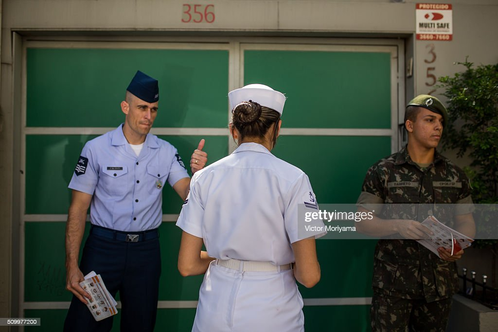 Officers of the Army, Navy and Air Force reach out to Brazilian residents in a push for public awareness of the Zika virus and the mosquito that transmits it in all Brazilian states on February 13, 2016 in Sao Paulo, Brazil. Today some 220,000 soldiers are working across the country to raise awareness.