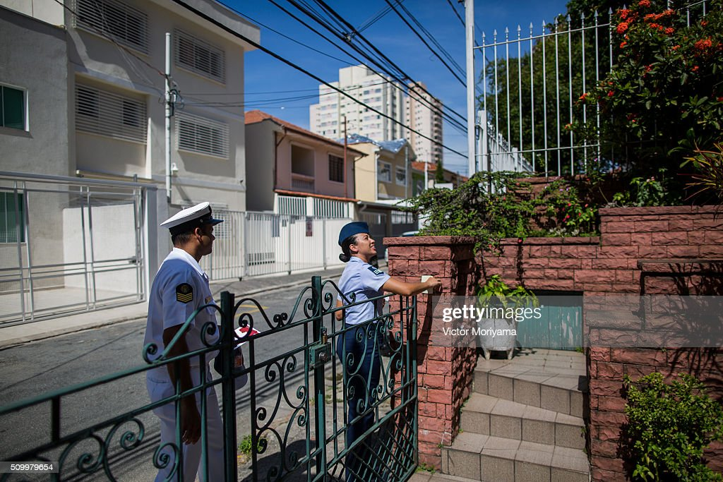 Officers of the Army, Navy and Air Force reach out to Brazilian residents in a push for public awareness of the Zika virus and the mosquito that transmits it on February 13, 2016 in Sao Paulo, Brazil. Today some 220,000 soldiers are working across the country to raise awareness.