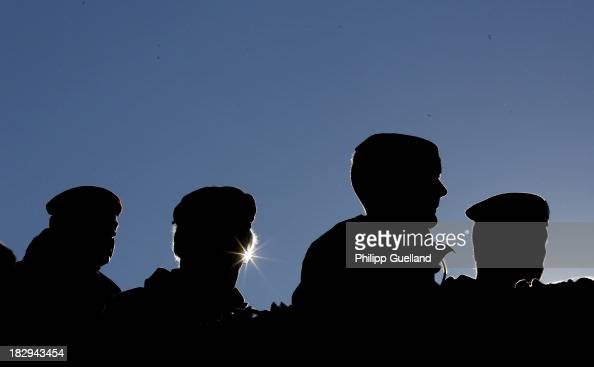 Officers of the Bundeswehr attend the annual military exercises held for the media at the Bergen military training grounds on October 2 2013 near...