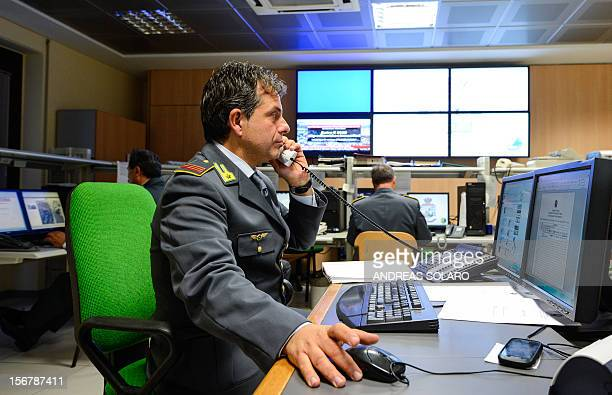 Officers of the Guardia di Finanzia speak on the telephone in the operation room of the regional comando of the Lazio area on November 20 2012 in...