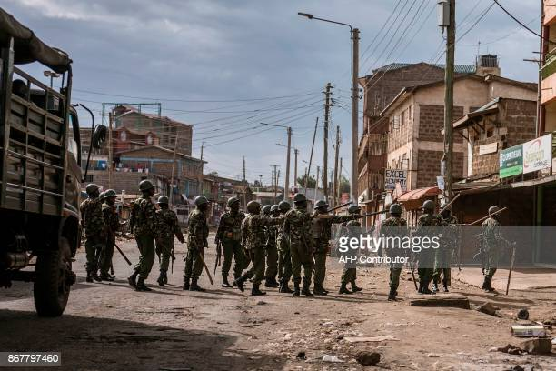 Officers of the Kenyan General Service Unit a paramilitary unit of the National Police Service of Kenya patrol in the streets of the Kawangware slum...