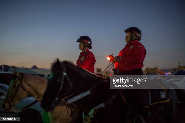 Officers on horseback patrol the campground as music fans camp out at the Empire Polo Club on the eve of the 2017 Coachella Valley Music And Arts...