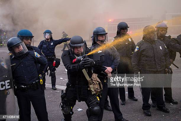 Officers pepper spray people near West North Avenue and Pennsylvania Avenue during a protest for Freddie Gray in Baltimore MD on Monday April 27 2015...