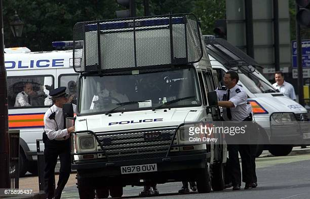 Officers push a police van during a fuel protest on Park Lane London 13th September 2000