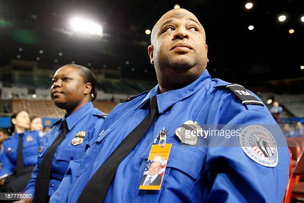 TSA officers Revance Gates Jr right and Elizabeth Washington arrive during a public memorial for Transportation Security Administration officer...