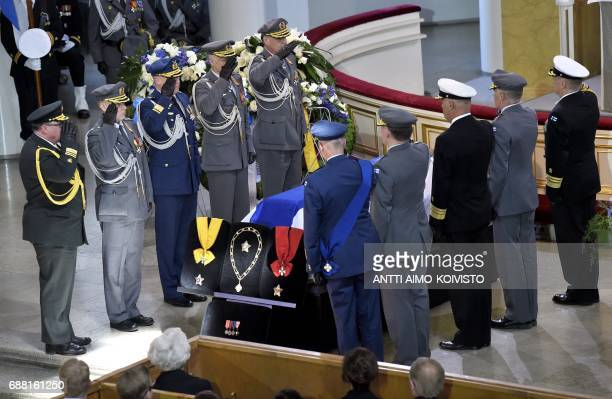 Officers salut the coffin of Finland's former President Mauno Koivisto during the state funeral ceremony at the Cathedral in Helsinki on May 25 2017...