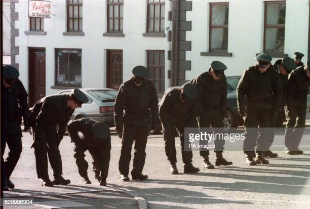 RUC officers search the street in front of the Railway Bar in Poyntzpass Co Armagh scene of a double murder last night See PA story ULSTER Shooting...