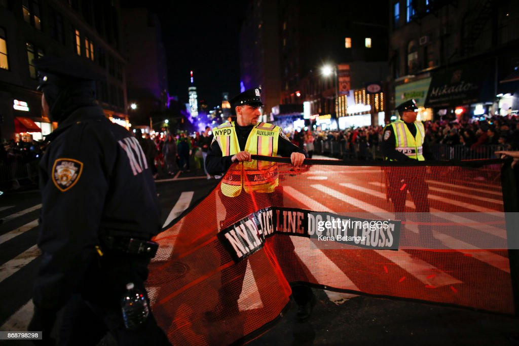NYPD officers stand guard during the annual Halloween parade after a man driving a rental truck struck and killed eight people on a jogging and bike path in Lower Manhattan on October 31, 2017 in New York City. Officials are reporting up to 8 dead and at least 15 people have been injured.