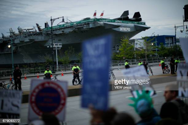 NYPD officers stand guard near the USS Intrepid where US president Donald Trump is hosting the visit of Australian Prime Minister Malcolm Turnbull...