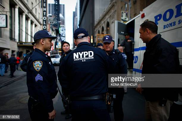 A NYPD officers stand in a area of Times Square after it was evacuated after a suspicious package call in New York on March 28 2016 Investigators...