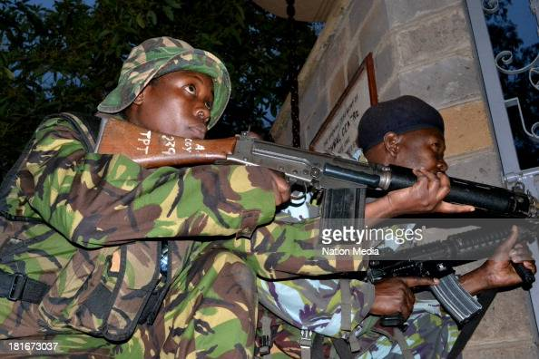 KDF officers take cover at Westgate Mall during a shootout with the terrorists on September 23 2013 in Nairobi Kenya The attack occurred on Saturday...