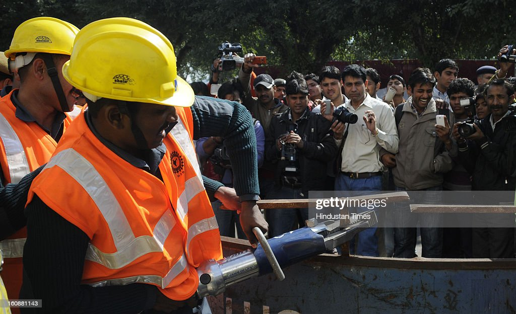 NDRF officers using the latest equipment during a Mock earthquake rescue drill, at Mini Secretariat, on February 7, 2013 in Gurgaon, India. Mock drill organized by Gurgaon Disaster Management Authority (GDMA) and the National Disaster Management Authority (NDMA) at many places in city to check the preparedness of officials and citizens to tackle natural calamities.