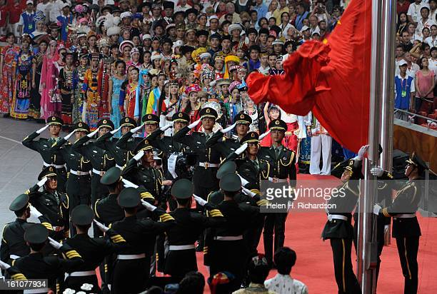 Officers with the Chinese Military stand at attention outside of the stadium as the fireworks display ended the opening ceremonies The opening...