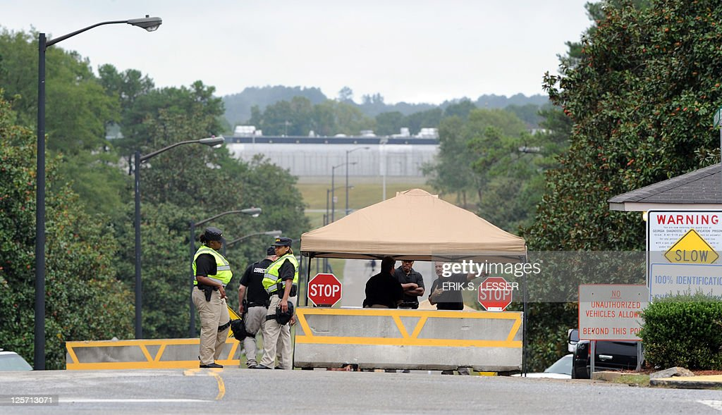 Officers with the Georgia Department of Corrections are seen at the entrance to the Georgia Diagnostic and Classification Prison in Jackson Georgia...