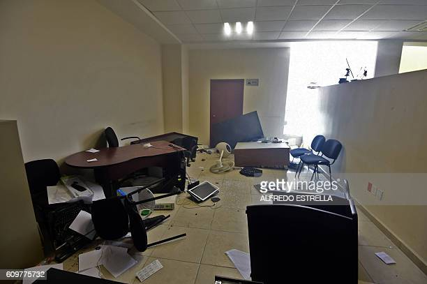 Offices were trashed during protests by students from the Raul Isidro Burgos teacher training college in Ayotzinapa in the palace of justice building...