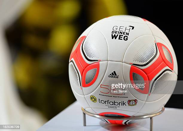 A official ball with the 'Geh Deinen Weg' logo is seen prior to the Bundesliga match between Borussia Dortmund and Bayer 04 Leverkusen at Signal...