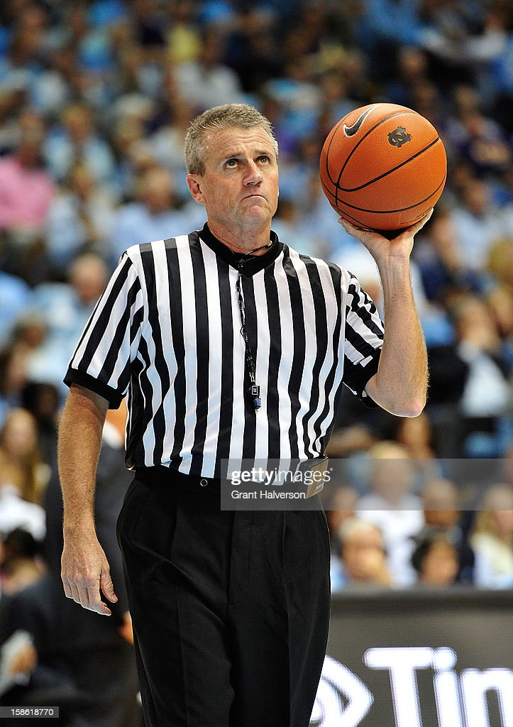 Official Brian Kersey holds a Nike basketball as he waits for play to resume between the North Carolina Tar Heels and the East Carolina Pirates during play at the Dean Smith Center on December 15, 2012 in Chapel Hill, North Carolina. North Carolina won 93-87.