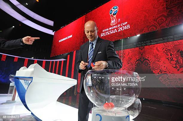 FIFA official Christian Unger stands on the stage on July 22 where the Preliminary draw for the 2018 FIFA World Cup will be held at a hall close to...