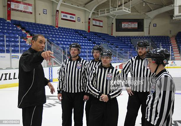 Official Derek Amell gives instruction to minor league officials at the Officials Clinic during Day 2 of NHL Kraft Hockeyville USA at the Cambria...
