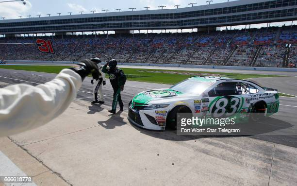 A NASCAR official directs Corey LaJoie back onto pit road during the O'Reilly Auto Parts 500 on Sunday April 9 2017 at Texas Motor Speedway in Fort...