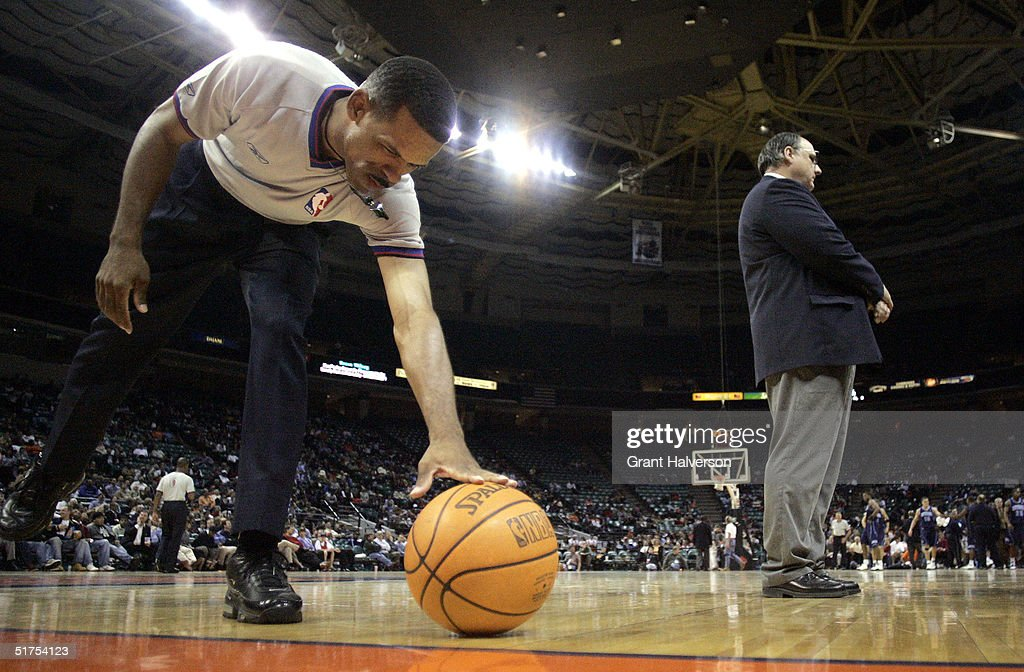 Official Eric Lewis retrieves the ball after a timeout during a game between the Utah Jazz and the Charlotte Bobcats on November 16 2004 at the...