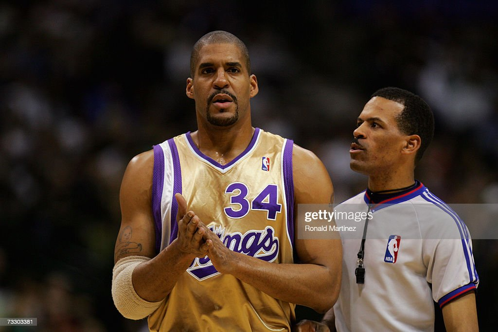NBA official Eric Lewis talks with Corliss Williamson of the Sacramento Kings during a game against the Dallas Mavericks at the American Airlines...