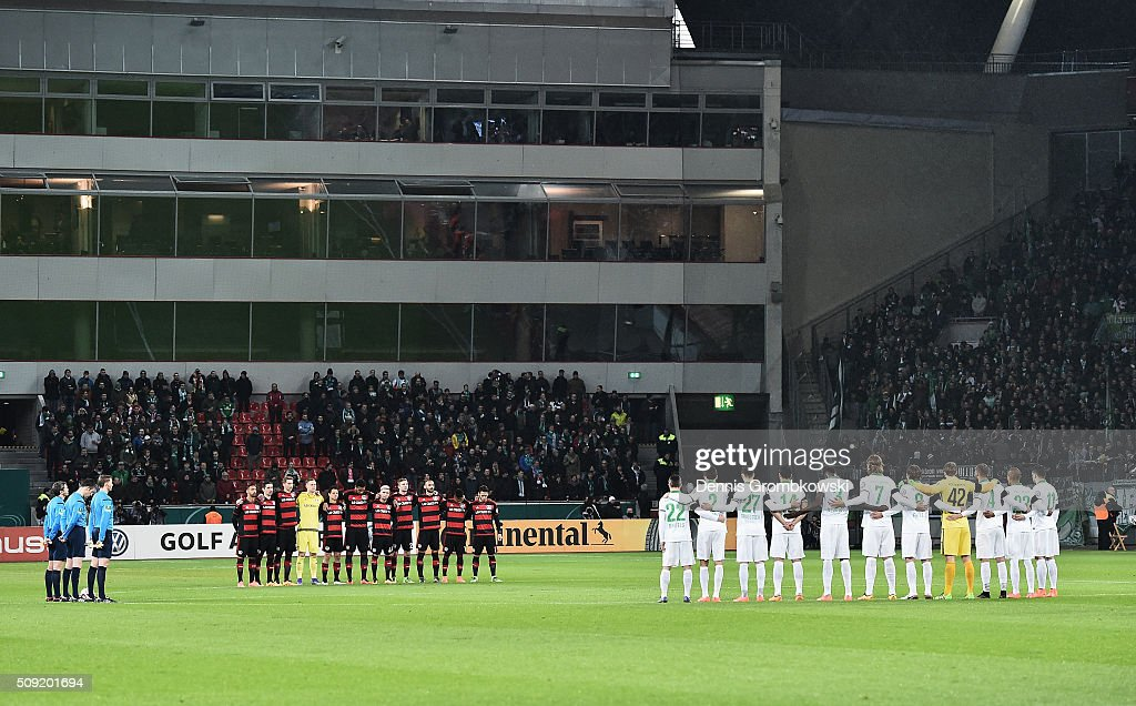 Official, fans and players observe a minutes silence to remember those who lost their lives in today's rail accident in Bavaria prior to the DFB Cup Quarter Final match between Bayer Leverkusen and Werder Bremen at BayArena on February 9, 2016 in Leverkusen, Germany.
