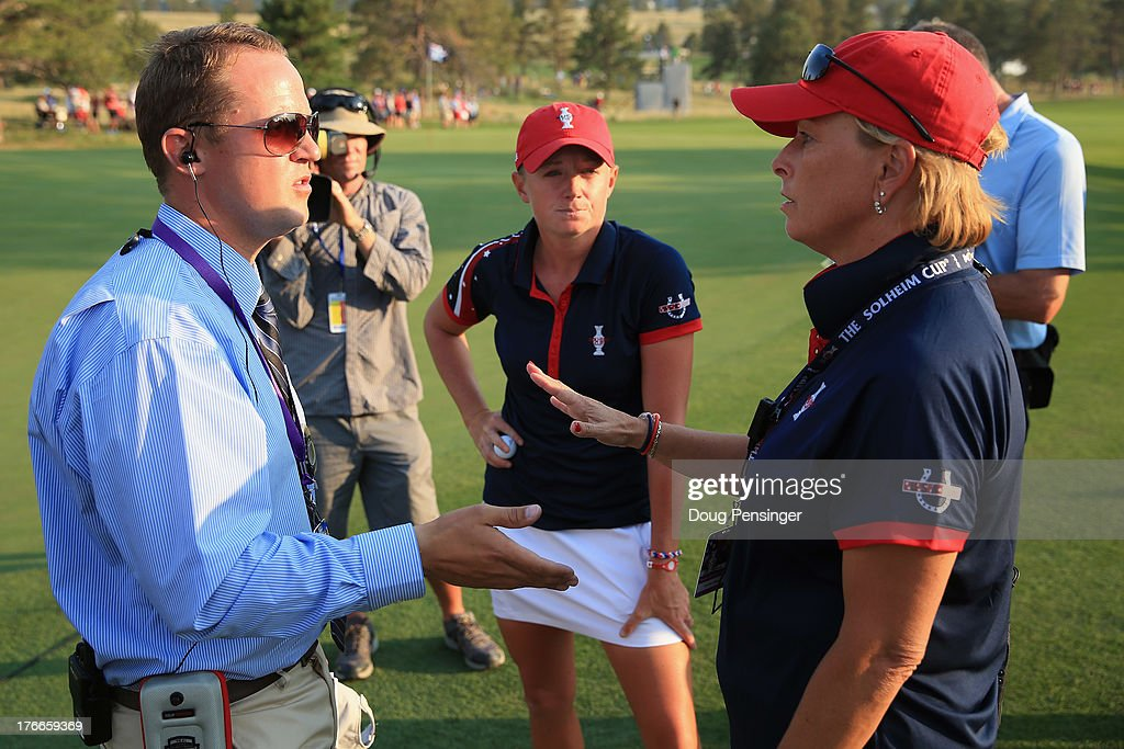 Official Fraser Monro, player <a gi-track='captionPersonalityLinkClicked' href=/galleries/search?phrase=Stacy+Lewis+-+Golfer&family=editorial&specificpeople=4217318 ng-click='$event.stopPropagation()'>Stacy Lewis</a> of the United States and assistant captain <a gi-track='captionPersonalityLinkClicked' href=/galleries/search?phrase=Dottie+Pepper&family=editorial&specificpeople=2351128 ng-click='$event.stopPropagation()'>Dottie Pepper</a> of the United States Team discuss a disputed ruling involing the play of Carlota Ciganda of Spain and the European Team on the 15th hole during the afternoon four-ball matches at the 2013 Solheim Cup on August 16, 2013 at the Colorado Golf Club in Parker, Colorado. Carlota Ciganda of Spain and Anna Nordqvist of Norway and the European Team defeated <a gi-track='captionPersonalityLinkClicked' href=/galleries/search?phrase=Stacy+Lewis+-+Golfer&family=editorial&specificpeople=4217318 ng-click='$event.stopPropagation()'>Stacy Lewis</a> and Lexi Thompson of the United States Team by one hole.