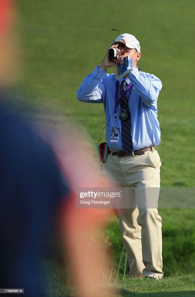 Official Fraser Monro uses a laser while determing where to make a ball drop after Carlota Ciganda of Spain and the European Team hit her second shot into a hazard on the 15th hole during the afternoon four-ball matches at the 2013 Solheim Cup on August 16, 2013 at the Colorado Golf Club in Parker, Colorado. Carlota Ciganda of Spain and Suzann Pettersen of Norway and the European Team went on to defeat Stacy Lewis and Lexi Thompson of the United States Team by one hole.