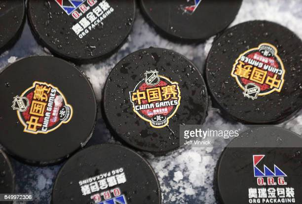 Official game pucks for the China Games sit on the ice during the Los Angeles Kings practice at MercedesBenz Arena September 20 2017 in Shanghai...