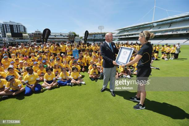 Official Guinness World Record adjudicator Glenn Pollard presents former England captain Charlotte Edwards with a certificate confirming the...